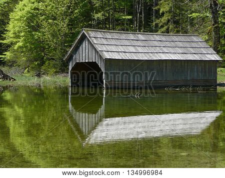 wood house for boat on a lake side