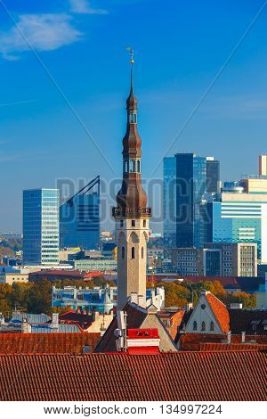 Aerial cityscape with old town hall spire and modern office buildings skyscrapers in the background in Tallinn in the day, Estonia