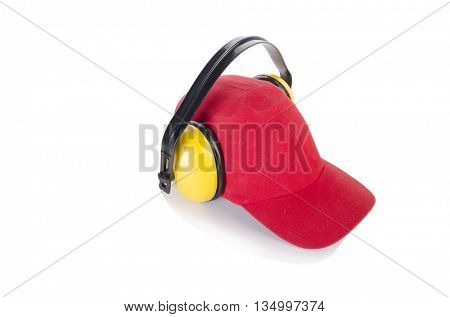 Red baseball cap with noise headphones isolated on white