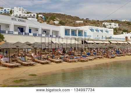 MYKONOS, GREECE - JUNE 9, 2010: People Enjoying a Vacation on Mediterranean Island of Mykonos Greece