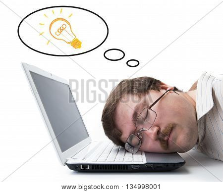 portrait of a man sitting on a laptop with an idea