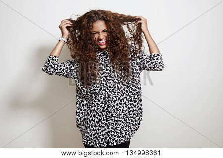 Woman Do Not Like Her Hair. Touching It And Looking At Camera