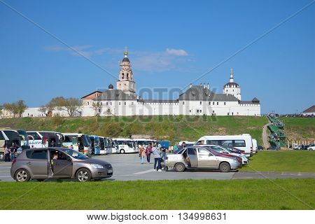SVIYAZHSK, RUSSIA - MAY 02, 2016: Cars are on the tourist car park beneath the walls of Holy Dormition Monastery