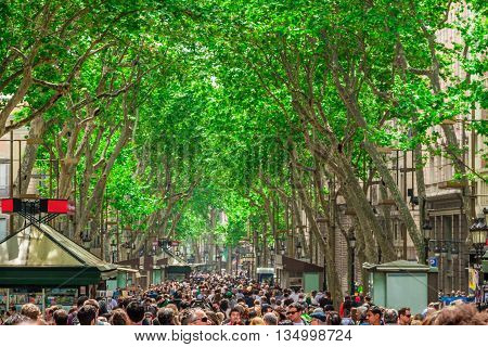 Barcelona Spain - May 1 2015: The busy high street of La Rambla in Barcelona during the day on May 1 2015 Catalonia Spain