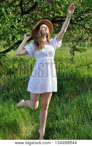 portrait of a teenage girl in the summer garden in sunny day