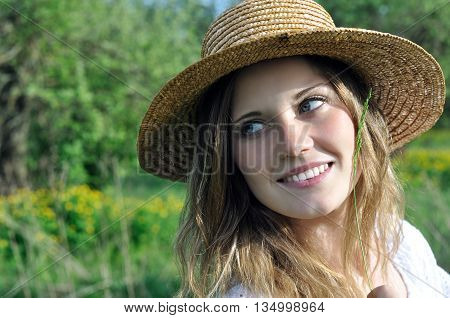 portrait of a teenage girl in the meadow in sunny day