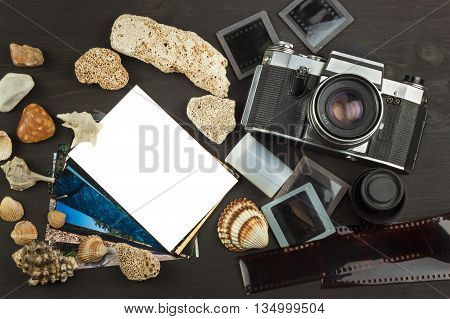 Old photos of the seaside holiday. The old camera. Memories of the sea. Family album photos. Memories of youth. Greetings from the seaside holiday. Equipment artistic photographer.