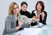 pic of loan-shark  - three women working together in an estate agency - JPG