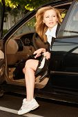 Business Woman Getting Out Of Car As She Arrives At Work