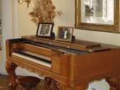 image of grand piano  - old piano musical instrument in a room - JPG