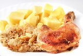 stock photo of curry chicken  - Chicken with potatoes and cabbage on a white plate - JPG