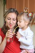 foto of drinking water  - Mom and litte child Sipping water together - JPG