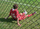 picture of sports injury  - injured soccer player with ice bag resting on sidelines - JPG