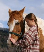 stock photo of say goodbye  - girl saying goodbye to her paint horse - JPG