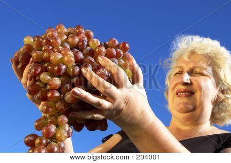 Mature Woman And Grapes