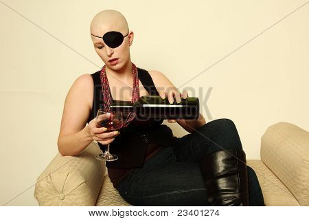 Bald Girl on White pouring wine