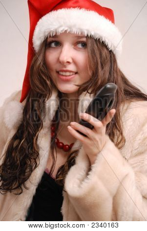 Young Model In Santa Claus Hat With Phone