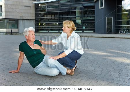 Passerby Helping Sick Senior Woman