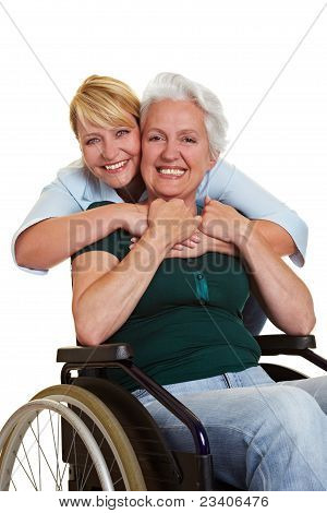 Woman Embracing Disabled Senior Woman