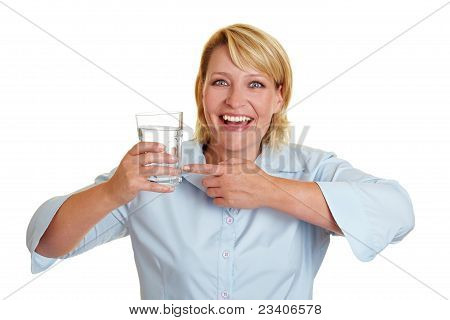 Woman Pointing To Glass Of Water