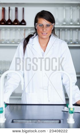 Portrait of a female scientist in a laboratory looking at the camera