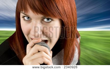 Girl Singing Karaoke On Microphone