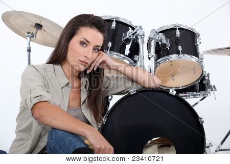 Brunette sat in front of drum kit