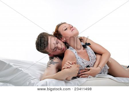 lovers in bed at morning sex isolated