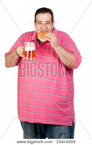 Fat Man Drinking A Jar Of Beer And Eating Hamburger