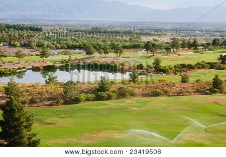 Water Sprinklers On A Desert Golf Course