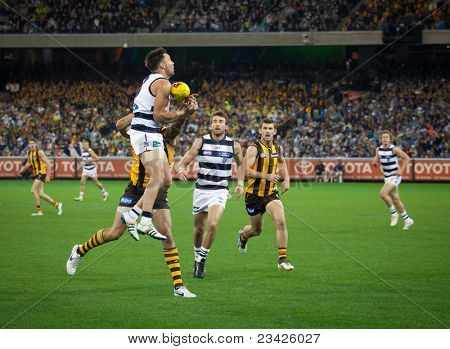 MELBOURNE - SEPTEMBER 9 : Jimmy Bartel takes a strong mark during Geelong's win over Hawthorn - September 9, 2011 in Melbourne, Australia.