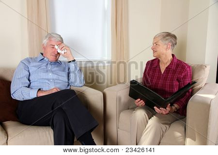 Woman Counseling a Man in Her Office