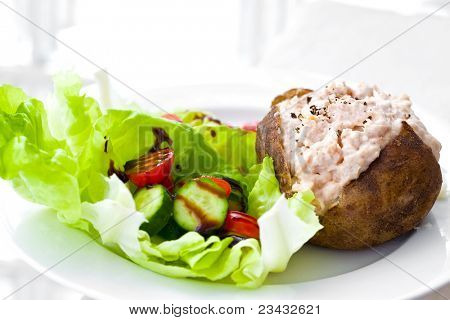 Freshly baked jacket potato with tuna mayonnaise and salad