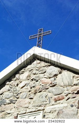 Cross From Metal At Old Church Roof