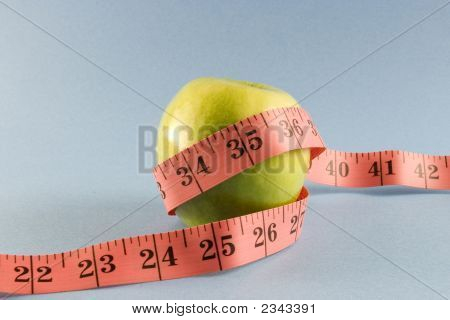Yellow Apple With A Measuring Tape.