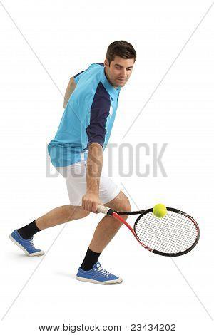 Male Tennis Player Hitting The Ball