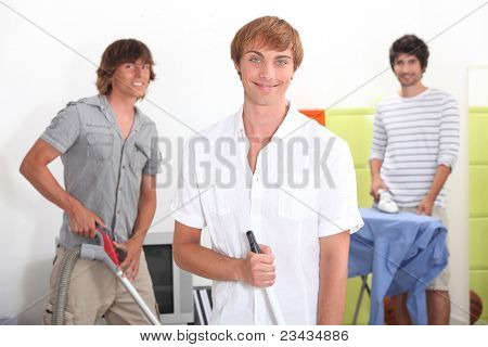 Three lads doing their chores