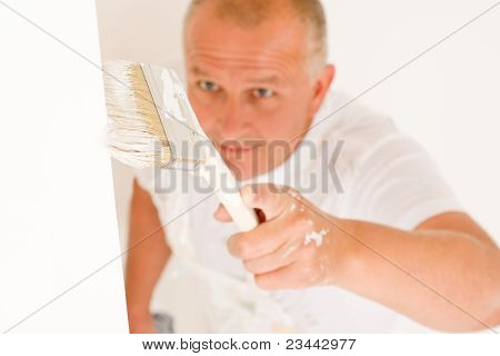 Home Decorating Mature Man Painting Wall Brush