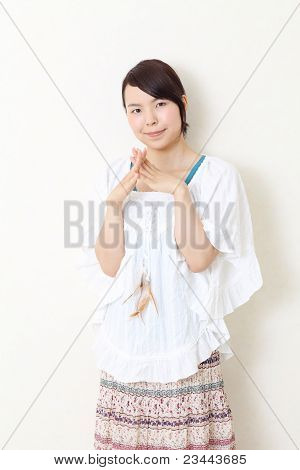 Young asian woman leaning on the wall