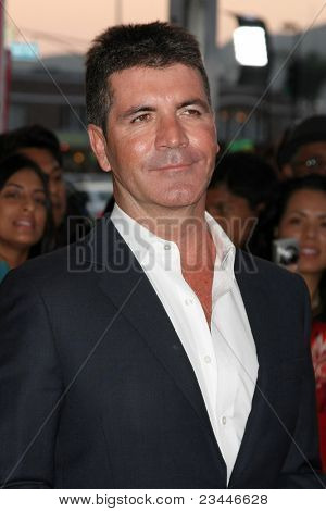 LOS ANGELES - SEP 14:  Simon Cowell arriving at the X-Factor Premiere Screening at ArcLight Theater on September 14, 2011 in Los Angeles, CA