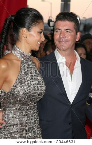 LOS ANGELES - SEP 14:  Nicole Scherzinger, Simon Cowell arriving at the X-Factor Premiere Screening at ArcLight Theater on September 14, 2011 in Los Angeles, CA