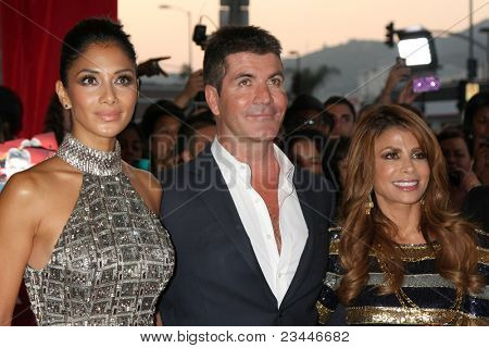 LOS ANGELES - SEP 14:  Nicole Scherzinger, Simon Cowell, Paula Abdul arriving at the X-Factor Premiere Screening at ArcLight Theater on September 14, 2011 in Los Angeles, CA