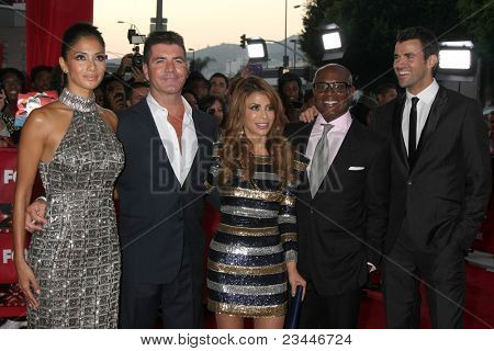 LOS ANGELES - SEP 14:  Nicole Scherzinger, Simon Cowell, Paula Abdul, Antonio Reid, Steve Jones arriving at the X-Factor Premiere Screening at ArcLight Theater on September 14, 2011 in Los Angeles, CA