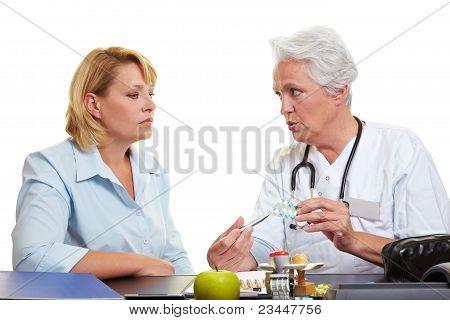 Elderly Doctor Offering Medication