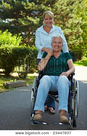Woman Driving Senior Woman In Wheelchair