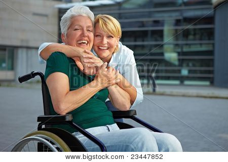 Smiling Disabled Senior Woman In Wheelchair