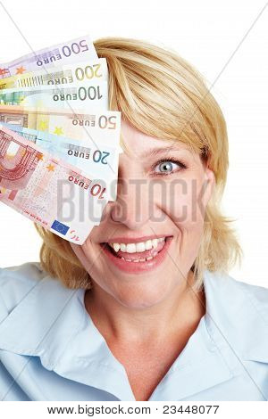 Woman With Euro Bills In Front Of Eyes