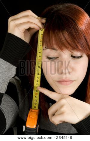 Girl Pointing At A Measuring Tool