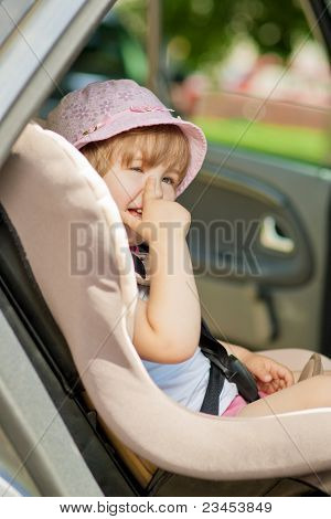 Happy Kid In Safety Seat