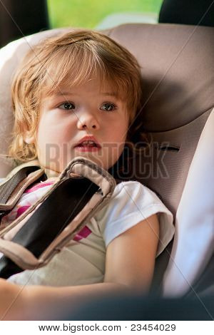 Kid Fastened On Safety Seat